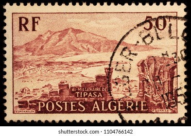LUGA, RUSSIA - JANUARY 23, 2018: A stamp printed by ALGERIA shows view of Chenoua Mountain and Tipaza - Berber speaking city and capital of Tipaza Province, Algeria, circa 1955.