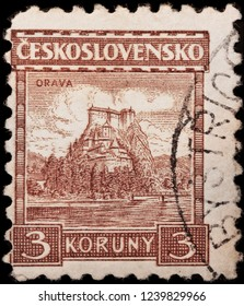 LUGA, RUSSIA - JANUARY 23, 2018: A stamp printed by CZECHOSLOVAKIA shows beautiful view of Orava Castle -  the major landmark in the Orava region, Slovakia, circa 1931