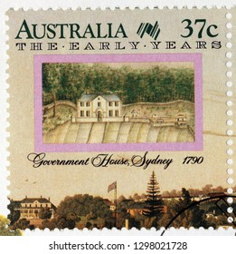 LUGA, RUSSIA - JANUARY 24, 2019:  A stamp printed by AUSTRALIA shows view of Government House, Sydney 1790, landscape by naval officer and illustrator George Raper, circa 2000.