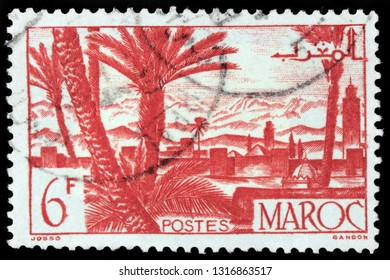 LUGA, RUSSIA - JANUARY 24, 2019: A stamp printed by MOROCCO shows view of Marrakesh - a major city of the Kingdom of Morocco, circa 1947.