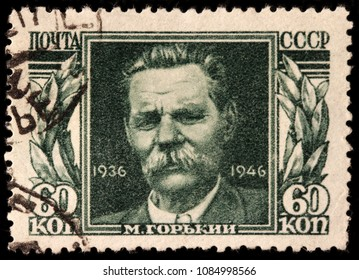 LUGA, RUSSIA - JANUARY 31, 2018: A stamp printed by RUSSIA (USSR) shows image portrait of famous Russian writer Maxim Gorky (Alexei Maximovich Peshkov), circa 1946