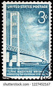 LUGA, RUSSIA -  JANUARY 31, 2018: A stamp printed by UNITED STATES shows beautiful view of the Mackinac Bridge connecting Upper and Lower Peninsulas of Michigan, circa 1958