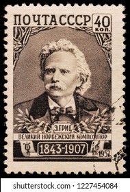 LUGA, RUSSIA -  JANUARY 31, 2018: A stamp printed by RUSSIA (USSR) shows image portrait of famous Norwegian composer and pianist Edvard Hagerup Grieg, circa 1957