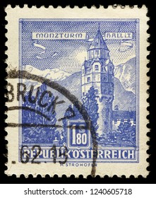 LUGA, RUSSIA - JANUARY 31, 2018: A stamp printed by AUSTRIA shows view of the Mint Tower in Hall town, Tyrol, Austria, circa 1960