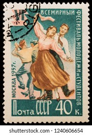 LUGA, RUSSIA - JANUARY 31, 2018: A stamp printed by RUSSIA (USSR) shows funny funny dancing young people, circa 1957