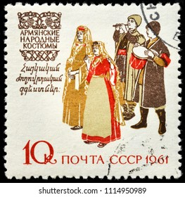 LUGA, RUSSIA - JUNE 07, 2018: A stamp printed by RUSSIA (USSR) shows people in Armenian traditional dress, circa 1961