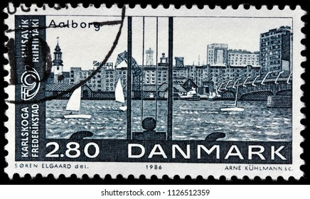 LUGA, RUSSIA - JUNE 07, 2018: A stamp printed by DENMARK shows beautiful view of Aalborg - Denmark's fourth largest city, circa 1986