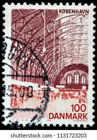 LUGA, RUSSIA - JUNE 07, 2018: A stamp printed by DENMARK shows beautiful Interior of the Central Railway Station in Copenhagen, circa 1976