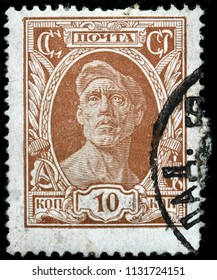 LUGA, RUSSIA - JUNE 07, 2018: A stamp printed by RUSSIA (USSR) shows engraving after sculpture Worker by famous Russian sculptor Ivan Shadr, circa 1927