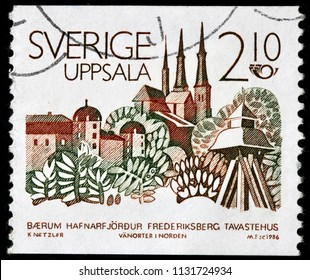 LUGA, RUSSIA - JUNE 07, 2018: A stamp printed by SWEDEN shows beautiful view of Uppsala - the capital of Uppsala County and the fourth largest city of Sweden, circa 1986