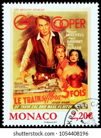 LUGA, RUSSIA - MARCH 17, 2018: A stamp printed by MONACO shows famous Gary Cooper, Grace Kelly and Katy Jurado starring in American Western film High Noon, circa 2017