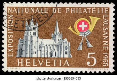 LUGA, RUSSIA - OCTOBER 15, 2019: A stamp printed by SWITZERLAND shows Cathedral of Notre Dame of Lausanne located in city of Lausanne, in the canton of Vaud in Switzerland, circa 1955