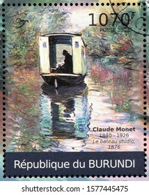 LUGA, RUSSIA - OCTOBER 15, 2019: A stamp printed by BURUNDI shows painting The Studio Boat by famous French Impressionist style artist Claude Monet, circa 2012.