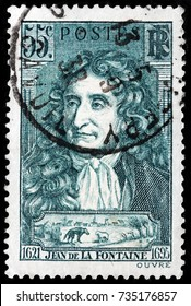 LUGA, RUSSIA - OCTOBER 6, 2017: A stamp printed by FRANCE shows image portrait of Jean de La Fontaine - a French fabulist and one of the most widely read French poets, circa 1938
