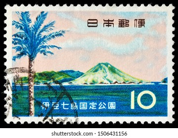 LUGA, RUSSIA - SEPTEMBER 01, 2019: A stamp printed by JAPAN shows Phoenix Tree and Hachijo Island (Hachijo-jima) i - a volcanic Japanese island in the Philippine Sea, circa 1963.