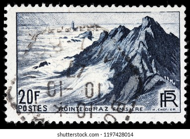 LUGA, RUSSIA - SEPTEMBER 12, 2018: A stamp printed by FRANCE shows view of the Pointe du Raz - a promontory that extends into the Atlantic from western Brittany, in France, circa 1946
