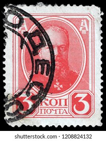 LUGA, RUSSIA - SEPTEMBER 12, 2018: A stamp printed by RUSSIA shows Alexander III the Emperor of Russia, King of Poland, and Grand Duke of Finland from 1881 until 1894, circa 1913