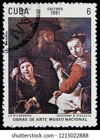 LUGA, RUSSIA - SEPTEMBER 12, 2018: A stamp printed by CUBA shows painting Spinner by Italian Rococo painter of genre scenes Giovanni Battista Piazzetta, circa 1981