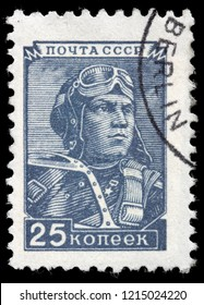 LUGA, RUSSIA - SEPTEMBER 12, 2018: A stamp printed by RUSSIA (USSR) shows Russian military pilot, circa 1948