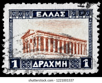 LUGA, RUSSIAN - JUNE 6, 2018: A stamp printed by GREECE shows view of the Temple of Hephaestus, Athens, circa 1927.
