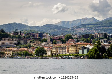 LUGANO, ITALY - MAI 28, 2018: View of embankment of Lugano Lake and mountains. Lake Lugano (Lago di Lugano) is nestled between Lake Maggiore and Lake Como and lies partly in Switzerland.