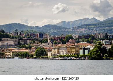 LUGANO, ITALY - MAI 28, 2018: View of embankment of Lugano Lake and mountains. Lake Lugano (Lago di Lugano) is nestled between Lake Maggiore and Lake Como and lies partly in Switzerland.