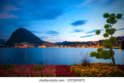 Lugano and the Lake Lugano (Lago di Lugano) at night.