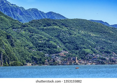 Lugano Lake and mountains. Lake Lugano (Lago di Lugano) is nestled between Lake Maggiore and Lake Como and lies partly in Switzerland and partly in Italy. Lugano, Switzerland.