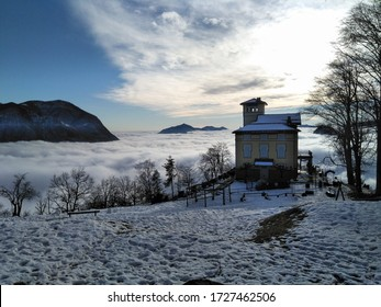 Lugano, Monte Bré: Panorama with fog in the valley below.