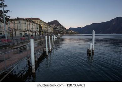 Lugano, Switzerland - 10 January 2019: Boulevard of Lugano near the lake with poles for the boats