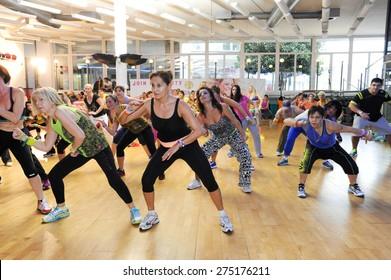 Lugano, Switzerland - 10 november 2013: People dancing during Zumba training fitness at a gym of Lugano on Switzerland