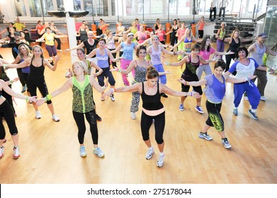 Lugano, Switzerland - 10 november 2013: People dancing during Zumba training fitness at a gym of Lugano on Switzerland