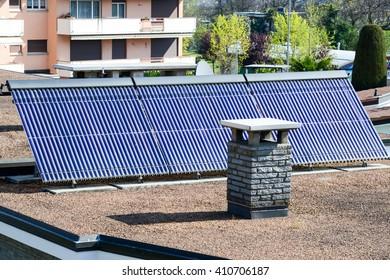 Lugano, Switzerland - 11 april 2016: Solar panel system on house roof of Lugano on Switzerland