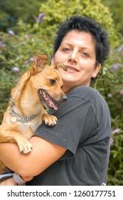 Lugano, Switzerland - 15 September 2002: woman with dog at the animal shelter of Lugano on Switzerland