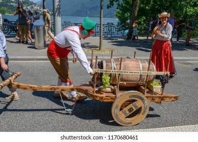 Lugano, Switzerland - 19 June 2017: people on the parade of wine festival at Lugano on Switzerland