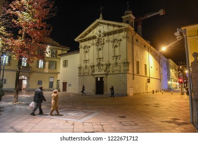 Lugano, Switzerland - 5 March 2016 - people walking in front of St. Rocco church at Lugano in Switzerland