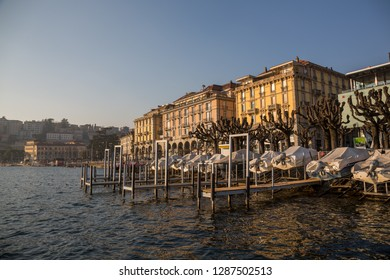 Lugano, Switzerland - 7 January 2019: Boulevard of Lugano with boats parked  along the boulevard edge