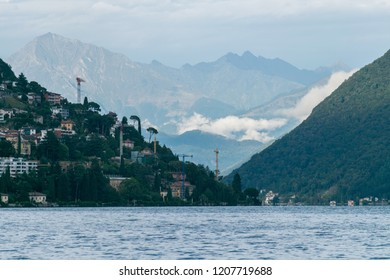 LUGANO, SWITZERLAND - August 13, 2018:  Beautiful landscape showing The expansion of Lugano and its surrounding mountains