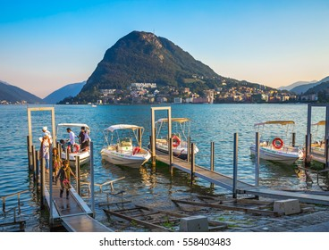 Lugano, Switzerland - July 20, 2016: Tourists are disembarking from the boat after the trip around the Lugano Lake.