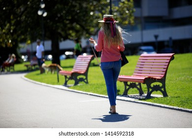 Lugano / Switzerland - June 01, 2019: Tourist walking near Lugano lake, Lugano, Switzerland, Europe