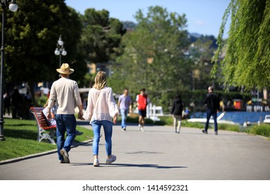 Lugano / Switzerland - June 01, 2019: Tourists walking near Lugano lake, Lugano, Switzerland, Europe