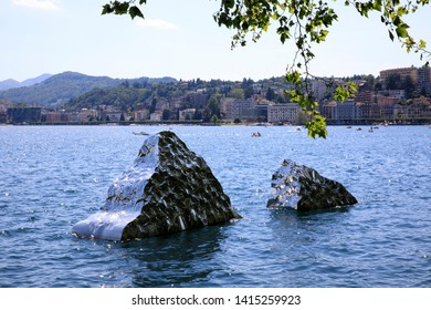 Lugano / Switzerland - June 01, 2019: Lugano lake view with Helidon Xhixha sculpture, Lugano, Switzerland, Europe
