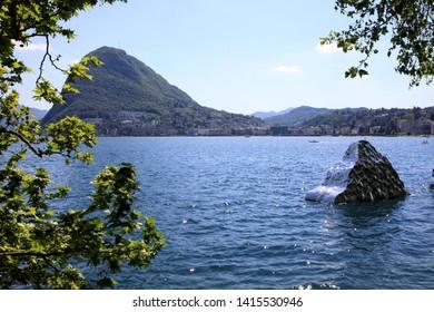 Lugano / Switzerland - June 01, 2019: Lugano lake view with Helidon Xhixha sculpture, Lugano, Switzerland, Europe