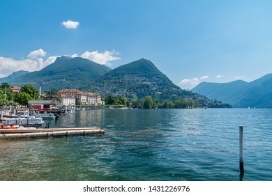 Lugano, Switzerland - June 1, 2019: The view of the mountains next to Lugano and lake Lugano (Lago di Lugano).