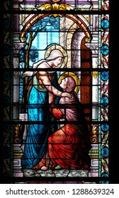 LUGANO, SWITZERLAND - JUNE 24, 2018: Visitation of the Virgin Mary, stained glass window in the Cathedral of Saint Lawrence in Lugano, Switzerland