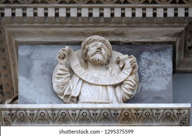 LUGANO, SWITZERLAND - JUNE 24, 2018: Prophet Isaiah, relief on the portal of the Cathedral of Saint Lawrence in Lugano, Switzerland