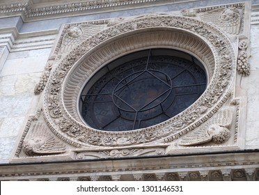 LUGANO, SWITZERLAND - JUNE 24, 2018: Rose window on the portal of the Cathedral of Saint Lawrence in Lugano, Switzerland
