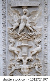 LUGANO, SWITZERLAND - JUNE 24, 2018: Relief on the portal of the Cathedral of Saint Lawrence in Lugano, Switzerland