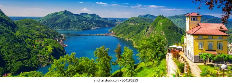 LUGANO, SWITZERLAND - Mai 2015 - Panorama Restaurant with stunning view to Lugano city, Lugano lake and Monte San Salvatore from Monte Bre, Ticino, Switzerland