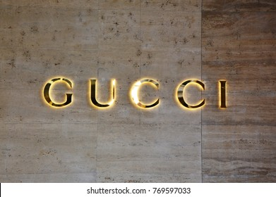 LUGANO, SWITZERLAND - NOVEMBER 27, 2017: flared sign of Gucci. Gucci is an Italian fashion and leather goods brand founded by Guccio Gucci in Florence in 1921. Gucci has about 425 stores worldwide